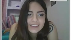 Slim brunette Italian girl showing boobs and butt on videochat