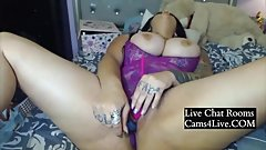 Tattooed brunette camgirl with big booty and monster tits
