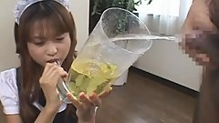 Japanese maid drinks piss from a directely filled funnel