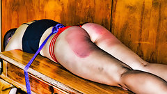 Tied and Double Strapped - (Spanking)